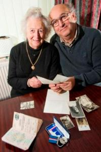 Josephine looks through some old photos and memorabilia from WWII with her son, Paul Roberts.