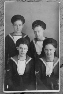 Ray, pictured bottom right, as young Royal Navy Telegraphist