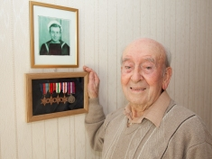 World War Two veteran with medals and photo