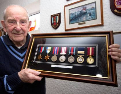Ron with his cherished collection of medals