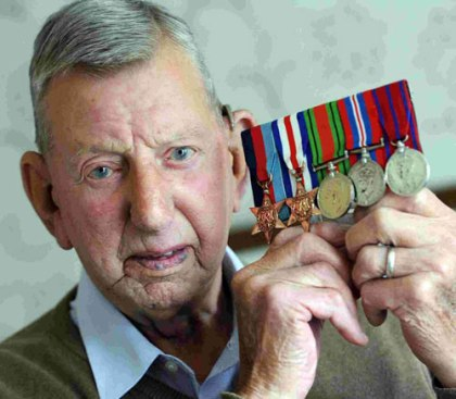 World War Two veteran holding medals